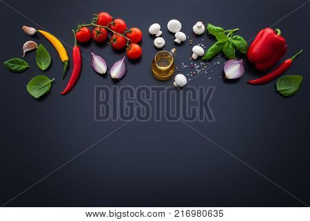 food ingredients and spices for cooking delicious italian pizza - food and drink