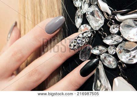 Black gray glam matte manicure with rhinestones and decoration