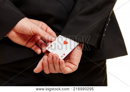 Hand from a businessman pulling an ace from a sleeve