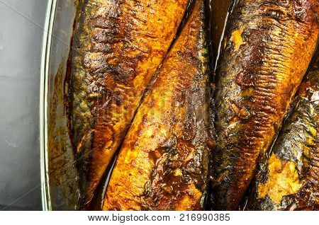 Mackerel in marinade, baked in a glass container