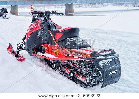 Rovaniemi Finland - March 2 2017: Red snowmobile on frozen lake at winter Rovaniemi Lapland in Finland