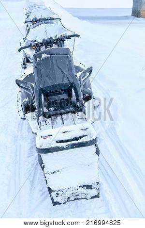 Rovaniemi Finland - March 2 2017: Black snowmobiles at the frozen lake at winter Rovaniemi Lapland Finland
