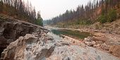 Meadow Creek on the South Fork of the Flathead River in the Bob Marshall Wilderness area during the 2017 fall fires in Montana United States poster