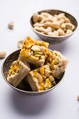 Kaju Katli or Kaju Burfi is an Indian Dessert made using dry cashew nuts with Khoa or khoya and sugar poster