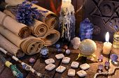 Ancient paper scrolls with runes and magic crystals. Occult, esoteric, divination and wicca concept. Mystic and vintage background poster