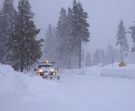Heavy snow. Winter Storm. Snow removal vehicle removing snow.