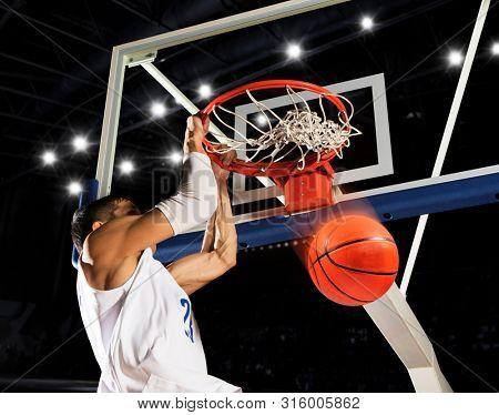 Dunk. Basketball man player. White  uniform. Number 23