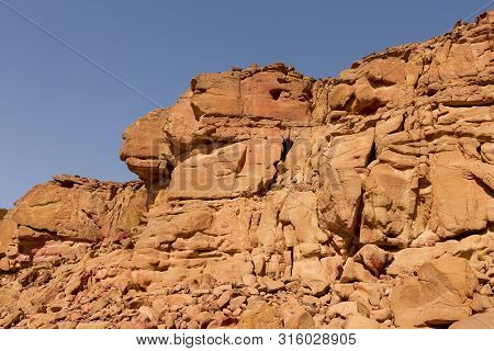 Desert Rocks Of Multicolored Sandstone Background. Coloured Canyon Is A Rock Formation On South Sina