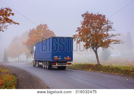 Transcarpathia, Ukraine - Oct 09, 2018: Truck On The Serpentine In Fog. Breaking Before The Road Tur
