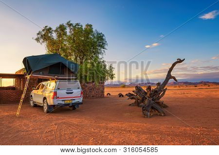 Betta, Namibia - March 27, 2019 : Tent Located On The Roof Of A Pickup 4x4 Car In A Desert Camp