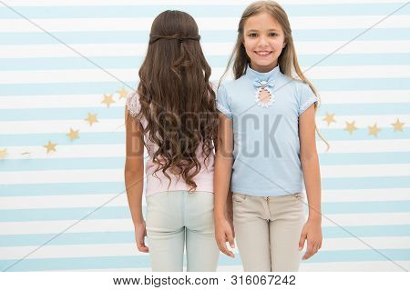 poster of Small girls with long curly hair. Healthy hair. Shampoo conditioner balm and mask. Curling styling. Beautiful curls. Brunette and blonde. Hairdresser salon services. Little kids with long hair.