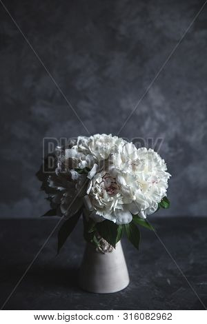 Beautiful Peonies On Grey Concrete Background. Wedding, Birthday, Valentines Day, Gift Or Womens Day