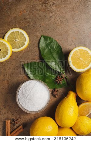 Citric Acid And Lemons On The Brown Background.