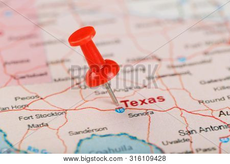 Red Clerical Needle On A Map Of Usa, Texas And The Capital Texan. Close Up Map Of Texas With Red Tac