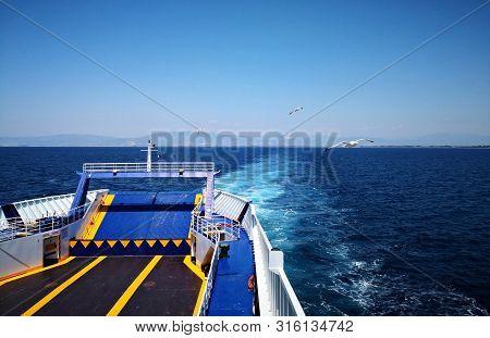 Ferryboat On The Sea.   Ferryboat In The Aegean Sea - Mediterranean Sea - Thassos, Greece.