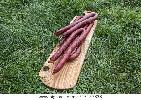 Traditional Slovak Sausages From Voivodina On Wooden Board, Kisac, Serbia