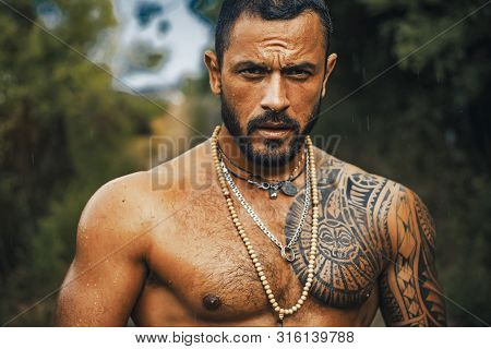 Brutal Handsome Man With Tattooed Body. Men Tattoo Casual Fashion. Portrait Of Brutal Handsome Male