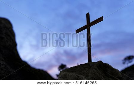 Concept or conceptual religious christian cross standing on rock on the mountain over beautiful sunset sky. A background for faith, religion belief, Jesus Christ or spiritual church 3D illustration