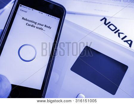 Paris, France - Sep 7, 2018: Rebooting Your New Nokia Withings Body Cardio Smart Scale Setting Up Wi
