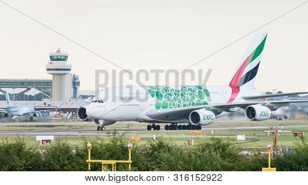London Gatwick Airport, Uk- August 07 2019: An Emirates Airlines Airbus A380-861 Decorated In Green