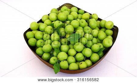 Green Plums, Fresh Plums, Sour Plums In A Container, Green And Sour Plums Close-up, Lots Of Green An
