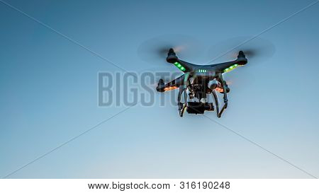 Spain-26 May, 2019:drone Flying With A Digital Camera And Blue Sky Background. Modern New Technology