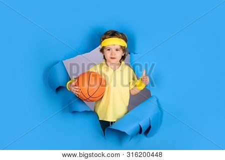 Happy Child Holds Ball Shows Thumb Up. Kid Activities. Little Basketballer. Sports Equipment. Active