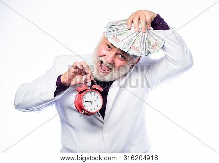 Money. Mature Man With Beard Hold Money. Clock Show Time. Time Is Money. Time Management. Business S