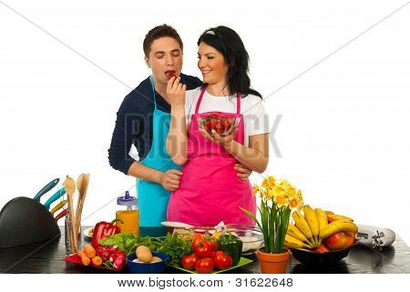 Happy Couple Eating Strawberry In Kitchen