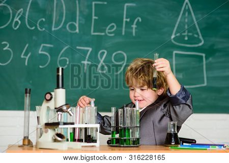 Basic knowledge primary school education. Educational experiment. Knowledge concept. Fascinating subject. Knowledge day. Kid study biology chemistry. Boy microscope and test tubes school classroom poster