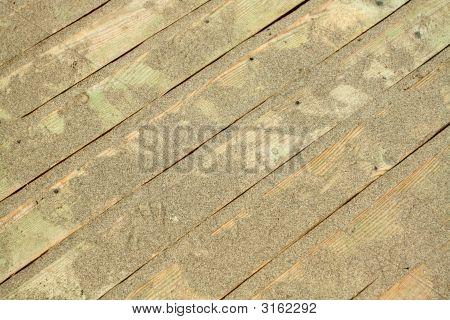 Golden Sands On The Wooden Floor