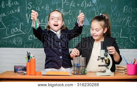 Girls School Uniform Busy With Proving Their Hypothesis. Science Concept. Gymnasium Students With In