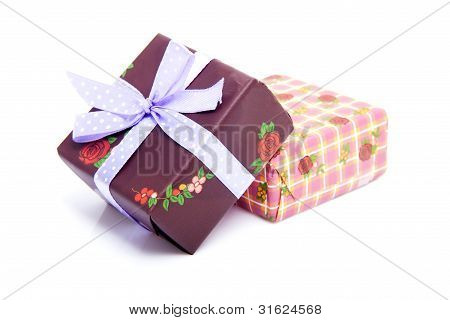 Pile Of Birthday Presents With Purple Bow