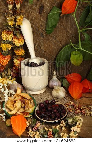 Still-life With Mortar, Dried Fruit And Flowers
