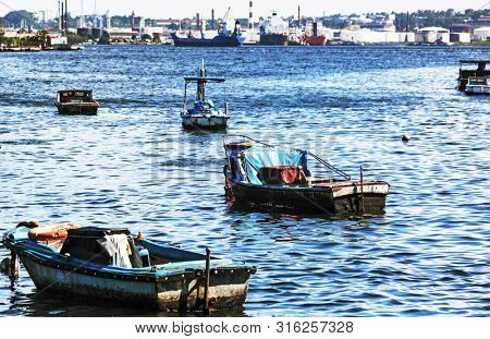 fishing boats against the commercial port
