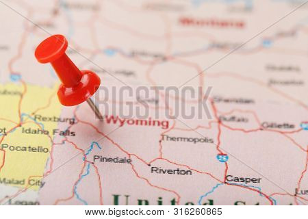 Red Clerical Needle On A Map Of Usa, Wyoming And The Capital Cheyenne. Close Up Map Of Wyoming With