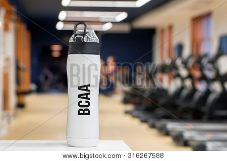 Plastic Bottle Or Cup With Branched-chain Amino Acid Drink Close Up