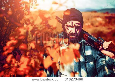 Hunter. Hunting Period, Autumn Season. Hunter With A Hunting Gun And Hunting Form To Hunt In Forest.