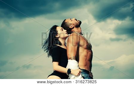 Sensual Concept For Sexy Couple. A Passion For Latin Man Body. Sensual Couple On Sky Background. Sex
