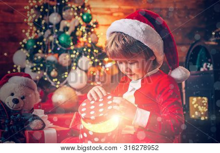 Santa Boy Little Child Celebrate Christmas At Home. Lovely Baby Enjoy Christmas. Family Holiday. Boy