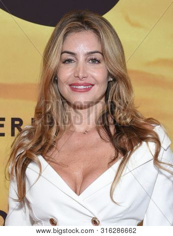 LOS ANGELES - JUL 23:  Sunessis De Brito arrives for the 'Serengeti' Special Screening on July 23, 2019 in Beverly Hills, CA