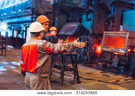 Workers In The Steel Mill On The Metallurgical Plant.