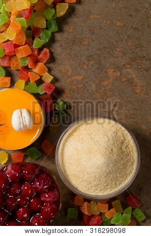 Gelatin and candied fruit on the wooden backgrounde. Top view. poster