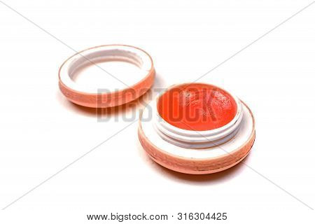 Red Lip Balm In A Jar Isolated Over White
