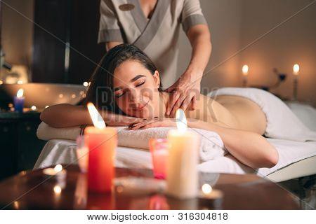 Spa, Massage. Young Dark-haired Beautiful Girl Doing Massage.