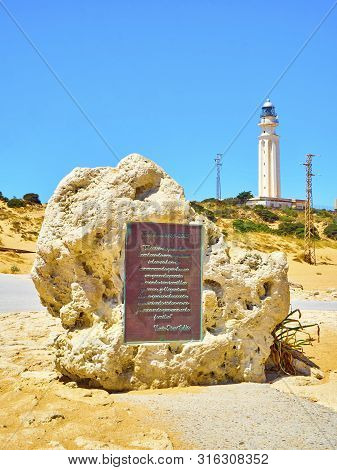 Barbate, Spain - June 26, 2019. Monument To The Battle Of Trafalgar With The Famous Lighthouse In Th