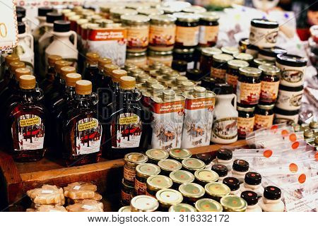 Montreal, Quebec - April 26th, 2013: Bottles And Cans Of Maple Syrup For Sale At Jean Talon Market I