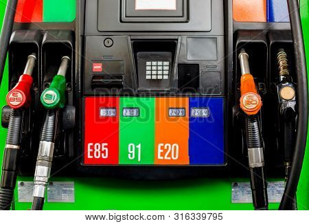 Gas Pump Nozzles In A Service Station, Close Up Fuel Nozzles At Gas Station, Panel And Dashboard Of