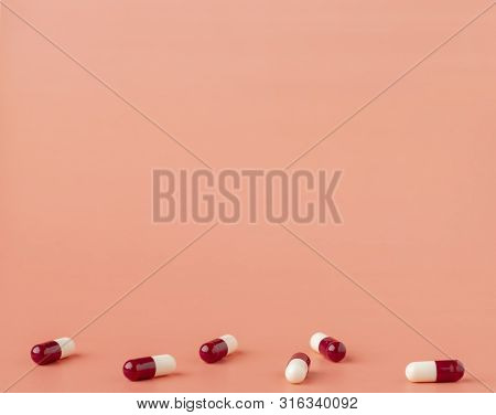 Scattering Of Red And White Drug Capsules