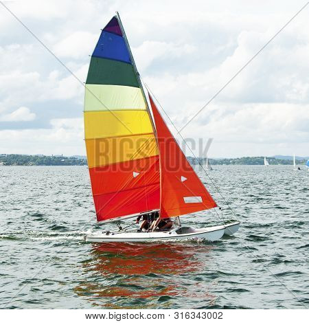Children Sailing In Small Colourful Boats And Dinghies For Fun And Competition. Teamwork By Junior S